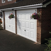 White GRP canopy garage doors